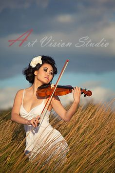 A beautiful young woman playing violin. Portrait photographer in CT,www.art-vision.us