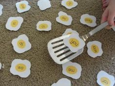 Easy egg flip game for teaching sight words. Say the word and child flips over the word when they find it. Adapt for phase by sound talking a word and child find word or word with particular sound in. by Abbey Saunter