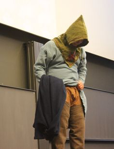 A young 'Viking' proudly displays what lies beneath the light blue robe. Trouser legs are attached to the 'underwear'.