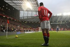 Ryan Giggs stands under the Old Trafford floodlights as he prepares to swing in a corner during @manutd's match against Birmingham in 2011.