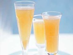Peach Bellini's,peach puree mixed with chilled champagne, more elegant than Bucks Fizz, perfect for spring