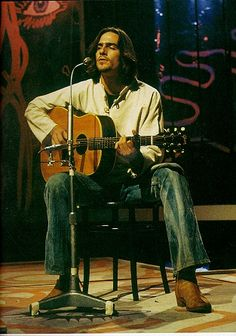 James Taylor. Knows his way around a fret board and has a deft and delightful finger picking style.
