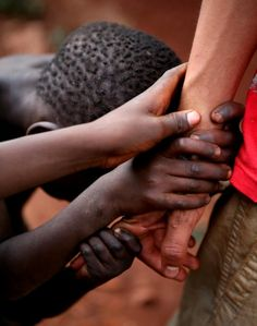 In Uganda, on a mission trip, the children were so needy but at the same time had so much joy.  This picture of my friends arm was pretty standard every time we stepped outside our doors.  They flocked us and we felt overcome.