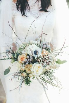 Bouquet Bride Bridal Flowers roses, spray roses, thistles, anemones, eucalyptus Whimsical Green White Fairy Lights Winter Wedding http://jesspetrie.com/