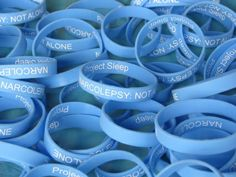 """buy me these? These light blue silicone bracelets read """"NARCOLEPSY: NOT ALONE"""" and """"Project Sleep"""" on the outside. Packets of 5 bracelets are available in two sizes! Selling Online, Selling On Ebay, Polycystic Ovary Syndrome, Awareness Campaign, Easy Jobs, Silicone Bracelets, Make A Change, Crohns, Be Your Own Boss"""