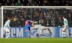Barcelona's Luis Suarez has his shot saved by Celtic's Craig Gordon during the UEFA Champions League match at Celtic Park Glasgow