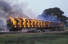 """Kingston, on the former North Creswick to Daylesford line during The fleet of retired """"Tait"""" Suburban Rolling stock are torched by the wreckers. Daylesford, Rolling Stock, Victoria Australia, Kingston, Past, Scene, Nature, Past Tense, Naturaleza"""