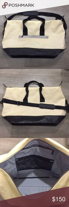 Lululemon Black & Cream Weekender Bag Lightly used Lululemon black and cream tote/gym/weekend bag.   Gray interior, 3 pockets.  One outside pocket.  Removable shoulder strap. 15 in L x 24 in W. lululemon athletica Bags Travel Bags