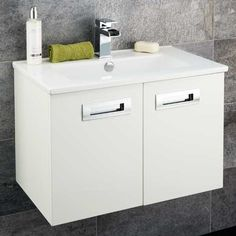 Aspen Compact 600 Wall Mounted 2 Door Vanity Unit | The Aspen Compact 600 wall mounted 2 door vanity unit. A fantastic and unique range of bathroom furniture the Aspen Compact range is designed with a short projection making it ideal for any modern bathroom including small bathrooms and cloakroom bathrooms. This 600 wall mounted unit has two soft close doors chrome finish handles and a high quality ceramic basin.