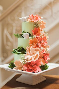 Cascading Orange Flowers on Pastel Green Cake