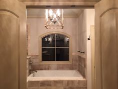 master bath with custom arched window