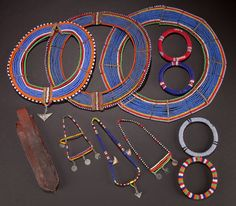Africa | Three beaded collars, four bangles, three earrings and a beaded leather ear pendant.from the Maasai people of Kenya | ca. early 20th century | 375$ for the lot ~ Sold