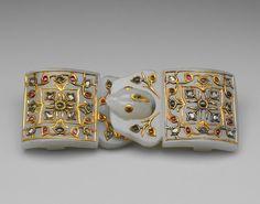 Buckle. 18th–19th century. India. Kundan work on jade, rubies, emeralds and diamonds.