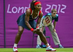 Serena Williams of the US waits for a serve from Serbia's Jelena Jankovic during their women's singles tennis match of the London 2012 Olympic Games at the All England Tennis Club in Wimbledon, southwest London, on July 28, 2012