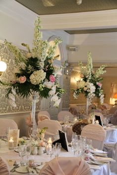 Classically Elegant Spring Wedding Our beautiful Crystal Candlesticks and Cake stands topped with a myriad of the most exquisite and sweet scented English garden blooms