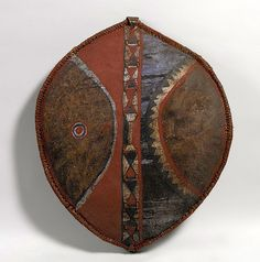 Africa | Shield from the Maasai people of Kenya or Tanzania | ca. 19th - 20th century | Leather, wood, paint and fur