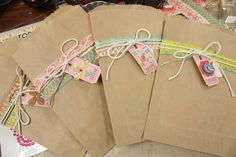 Mish Mash: Sacks with embellished  ticket tags...sacks can hold a card or little gifts like a candy bar. So cute! :)