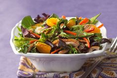 A bright assortment of vegetables, chicken and orange wedges topped with an Asian-inspired dressing makes for a restaurant-style salad made smarter.
