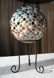 Going to have to find a bowling ball at a garage sale this summer to try this!! Bowling ball mosaic tile yard art!  Use silicone glue...