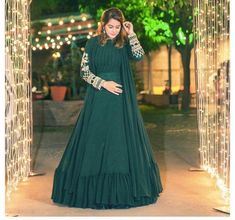 "Green Georgette Gown. Gold and pearl Embroidery. All type of Customization possible as per Requirement. Price Shown may vary as per Measurement. Shipping charges exclusive. [wpforms id=""184""] The post GREEN GEORGETTE WEDDING OUTFIT WITH GOLD AND PEARL EMBROIDERY appeared first on PEARL TRENDZ INDIA."