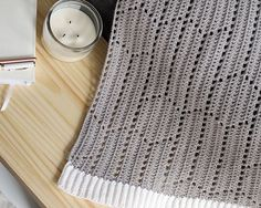 This light & airy crochet blanket pattern has a modern hexagon + chevron design. With 4 sizes including a baby/stroller blanket size, lapghan or crib blanket size, queen size, and king size you can crochet one for any part of your home. BONUS: the pattern also includes details on how to create a scarf, table runner, and shawl in this modern geometric filet crochet design!