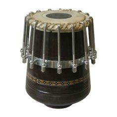 Tabla with 16 Bolts, Wooden Dayan Only (Package Of 3) by banjira. $572.09. Dayan only. Has 16 bolts for easy tuning and adjustment. Cushion and cover sold separately. The Dayan is made of rosewood or similar hardwood. Most Dayan are made in the city of Mumbai Nuts can be tuned with a standard wrench, not included. (Package Of 3). Save 50%!