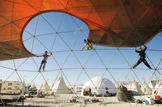 Action shot of a #Geodesic Pacific #Domes being set up at #BurningMan, one of our most popular venues!