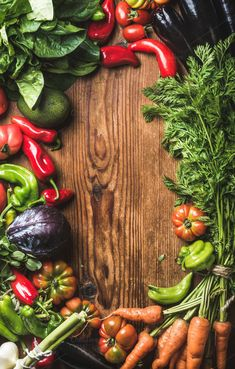 #Fresh raw vegetable ingredients  Fresh raw vegetable ingredients for healthy cooking or salad making over rustic wood background top view copy space vertical composition. Diet or vegetarian food concept