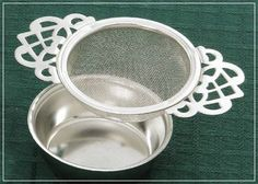 Victoria Tea Strainer with Drip Bowl by Lana's The Little House , http://www.amazon.com/dp/B004YKSTMI/ref=cm_sw_r_pi_dp_xA5Mqb1HJEHYH