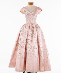 Pink satin evening gown with floral designs of sequins