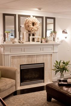 fireplace mantle - love the 4 vertical mirrors!! i need to do that! by brianna