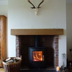 Huge thank you to Helen and Matt for supplying us with this fab photo of their completed installation.   The Mendip Churchill 8kw Multi Fuel Stove with oak beam.