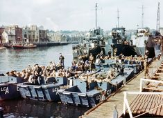 Scenes From D-Day, Then and Now | Boats full of United States troops waiting to leave Weymouth, Southern England, to take part in Operation Overlord in Normandy, June 1944. Click to the source to view a transition to the same view on April 5, 2014.