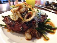 GRILLED NATURAL RIBEYE STEAK - (With walla walla onions and house compound butter) - Crow Restaurant - Seattle, WA