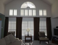 """Sun Burst Arch with Traditional Plantation Shutters and 2"""" Horizontal Blinds with Plain Top Flood size Drapery Panels"""