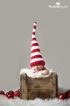 This little Christmas troll: | 29 Babies Who Totally Nailed Their First Christmas Photo Shoot