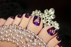 elegant purple pedicure with rhinestones