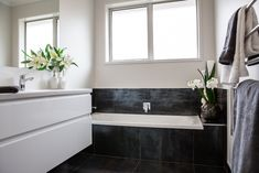 Black and white are perfect together – black absorbs, while white reflects. This combination creates a real impact in your bathroom. Built In Bath, Perfect Together, Room Tiles, New Builds, Auckland, Bathrooms, New Homes, Black And White, Interior Design