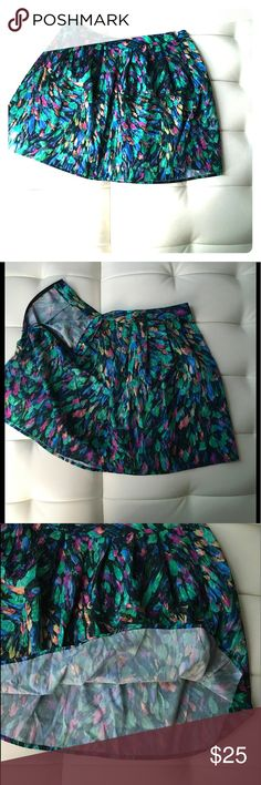 """Hinge multi colored circle mini skirt Very cute skirt perfect for summer, especially for vacation in the tropics with its vibrant colors. Pair with a white tank and gladiators and an arm full of bangles for an easy look. Skirt is 17"""" long with a side zipper. 100% polyester. In excellent condition Hinge Skirts Mini"""