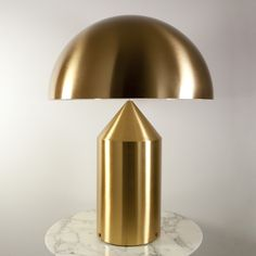 An iconic piece of Italian design, the Atollo Gold Table Lamp is a geometrically pleasing sculpture that adds to the ambiance of a room in more ways than one. http://www.ylighting.com/oluce-atollo-gold-table-lamp.html