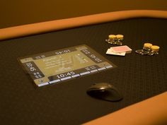 """If you're like us, you like to hold a home poker tournament every once in a while. My friends and I have been doing this for a few years, and have become used to using a computer or laptop as a blind clock, and to keep up with game and player statistics. A friend and I have been wanting to re-cover a used table he'd been given several months ago. A few weeks ago, while thinking about where in the """"Poker Room"""" the blind clock computer was going to go, I was struck by the craz..."""