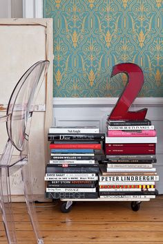 SO Matt and my future house. Ornate wallpaper + clear, Lucite chair (modeled after a traditional chair?!) + a stack of books about Dior, Peter Beard, etc.