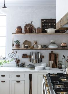 A built-in slot hides sheet pans and less-photogenic cutting boards. Photo: Beth Kirby