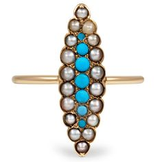 This delicate and feminine Victorian-era ring showcases bright blue turquoise cabochons surrounded by cultured seed pearl accents in a lovely marquise shaped design