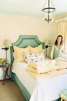 Sunny Guest Retreat - Gracious Guest Bedrooms - Southernliving. Thanks to a cheerful application of color and a new storage armoire, this homeowner has a place for her shoes and the in-laws. A mix of three different florals yields a layered look. A nail-studded fabric headboard, matching bed skirt, and wall sconces make for a grand bed.