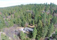 4440 Up Chick St, Placerville, CA 95667 — Close to Jenkinson Lake! Cute 2 bed/2 bath single story home sits on one very private acre. End of the road with new back deck, covered front porch, open floor plan, 2 car garage, tool shed, RV possible! Must See!