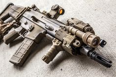 """10"""" FN SCAR 16S with Aimpoint T1, Insight PEQ-15, Surefire M600V (KM3), and Blue Force Gear padded VCAS."""