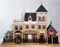 From the V&A's Museum of Childhood: This small dolls' house or villa was made by Thomas Risley in 1889 possibly from a kit. It is in the style of a brick house of about It has a glass conservatory and coach house on each side. Antique Dollhouse, Dollhouse Kits, Dollhouse Dolls, Dollhouse Miniatures, Cubby Houses, Fairy Houses, Doll Houses, Miniature Houses, Miniature Dolls