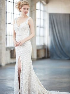 Floating button enclosures, a center slit and delicately scalloped lace create a truly unique bridal gown.   MJ303  http://www.charlottesweddings.com/for-the-bride/request-appointmen/