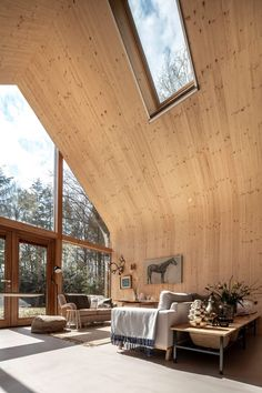 Amsterdam studio Woonpioniers has hidden a prefabricated wooden cabin with large windows and tall, curving interiors within a forest glade in the Netherlands. Building Companies, Building Systems, Barn Style House Plans, Amsterdam, Co Housing, Dutch House, Wooden Cabins, Wooden House, Minimal Home